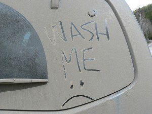 Wash Me written on dirty windows