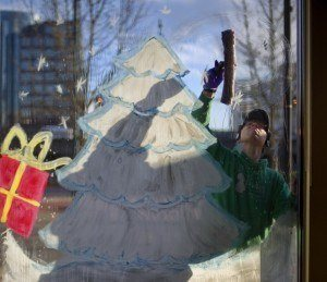 Painting store windows for Christmas and professional window cleaners